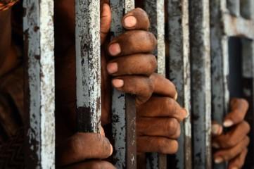 Prison-black-hands-on-bars